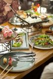Dining table with food, upright. A restaurant stock photo