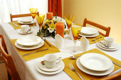 Dining table. Inside the house with the dishes ready for use Stock Image