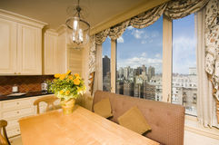 Dining table in kitchen nook penthouse new york Stock Photography