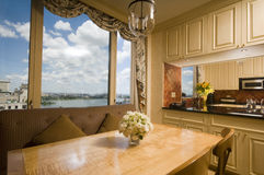 Dining table in kitchen nook penthouse new york Royalty Free Stock Images