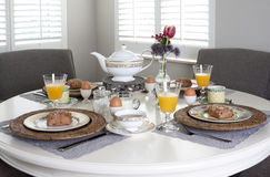 Dining table laid for breakfast Royalty Free Stock Photography