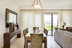 Dining Table in Luxury Condominium. View of dining table and view out sliding glass doors Royalty Free Stock Photo