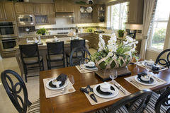 Dining table with luxury home kitchen. Royalty Free Stock Photos
