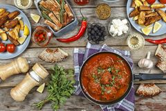 Dining table, Meatballs, baked potato wedges, ketchup, copy space. top view. Authentic Italian Meatballs. Dining table. Meatballs With parsley and cherry Stock Photos