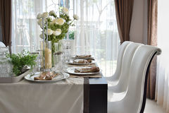 Dining table in modern home with elegant table setting Royalty Free Stock Photos