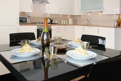 Dining Table in Modern Open Plan Apartment Royalty Free Stock Photography