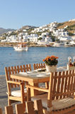 Dining table by Mykonos waterfront, Greece Stock Photography