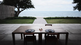 Dining Table near the Ocean in the Morning Royalty Free Stock Photos