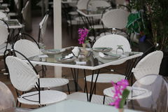 Dining table. Out door glass dining table set Royalty Free Stock Photo