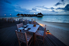 Dining table at the outdoor beach restaurant Stock Photos