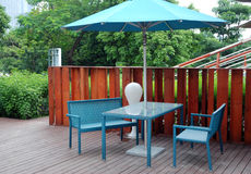 Dining table at the outdoor. Dining table with parasol at the outdoor Stock Photos