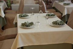Dining table with plates. In a cafe Stock Images