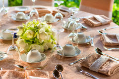 Dining table preparation in a luxury restaurant Stock Photo