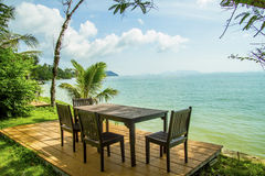 Dining table prepared for two on white sand beach Stock Photography