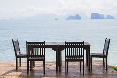 Dining table prepared for two on white sand beach Royalty Free Stock Image