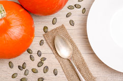 Dining table with pumpkins and seeds Stock Photo