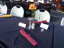 Dining Table Reserved at an Outdoor Restaurant. One of the town`s main thoroughfares, Park Avenue, is closed during the annual Summer Kick-Off/Cruisin' on the Stock Photography