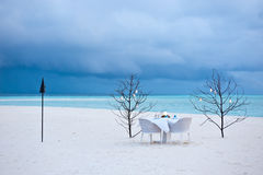 Dining table on the sand beach Royalty Free Stock Photography