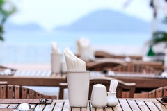 Dining table on sea and moutain background in sunshine. The dining table on sea and moutain background in sunshine royalty free stock photos