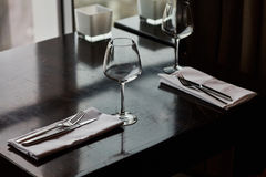 Dining table served with glasses, forks and knifes Stock Image