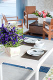Dining table set. With dish and flower Stock Photos