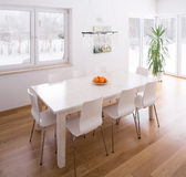 Dining table set. In bright modern interior Royalty Free Stock Photo