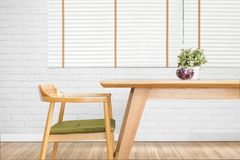 Dining table set with chair in the cozy dining room with white b stock image