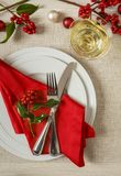 Christmas dinner table place setting with festive seasonal decorations Stock Images