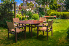 Dining Table set in Lush Garden Stock Photography