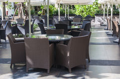 Dining Table Set. Modern set of outdoors rattan furniture in a restaurant Stock Images