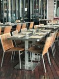 Dining table set at the terrace of restaurant Royalty Free Stock Image