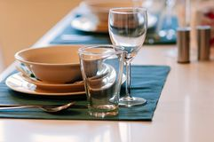 Dining table set up with glasses, blue table cloth stock photos