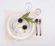Dining table setting white plate with candles, flower, wineglass Royalty Free Stock Photos