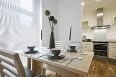 Dining table setup. And modern kitchen view Stock Image