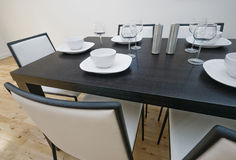Dining table setup. Modern luxury dining table setup with white leather chairs stock photography