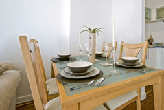 Dining table with setup. Modern glass top dining table with four seats and setup stock images