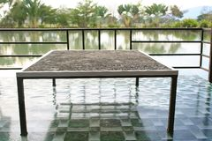 Dining table by sitting on the floor near lake,Thai style royalty free stock photo
