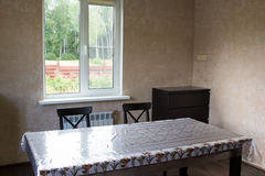 Dining table and two chairs in country house Royalty Free Stock Photos