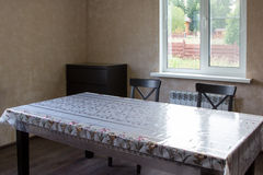 Dining table and two chairs in country house Stock Images