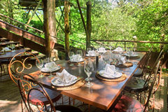 Dining table under trees Stock Photography