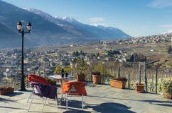Dining table with a view overlooking Sondrio, Italy. Dining table with a view overlooking Sondrio, an Italian town and comune located in the heart of the wine stock image