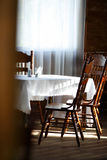 Dining table and wooden chairs Stock Image