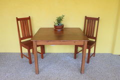 Dining table with yellow wall Royalty Free Stock Photography