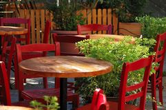 Dining tables and chairs in an outdoor cafe Stock Images