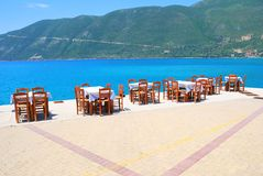 Dining tables with chairs by the sea Royalty Free Stock Photo