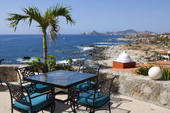 Dining tables with a great view of the Cabo San Lucas. Mexico and Lands End in the far background Stock Photos