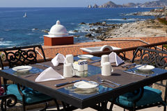 Dining tables with a great view of the Cabo San Lucas. Mexico and Lands End in the far background Stock Image