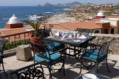 Dining tables with a great view of the Cabo San Lucas. Mexico and Lands End in the far background Stock Photography