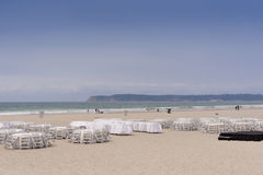 Dining tables on sandy beach. Stock Image