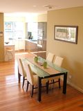 Dining in tonight... Dining area and kitchen Stock Photography